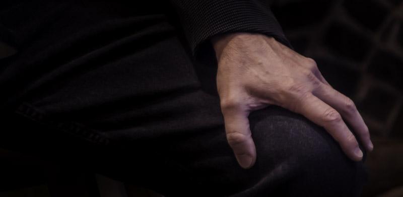 hand on knee - American God